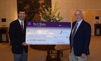 Scott Weeks presents $1000 grant to Royce Learning Center Executive Director Ron Wilson