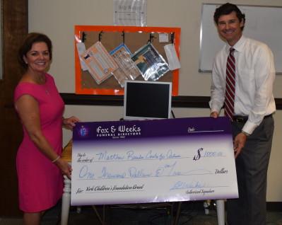 Fox & Weeks presents Matthew's Children's Foundation grant to Reardon Center for Autism