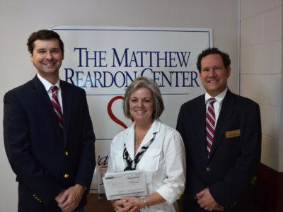 Fox & Weeks presents Matthews Children's Foundation  grant to Matthew Reardon Center for Autism